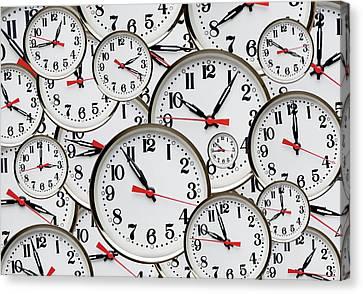 Jumbled Clock Times Canvas Print by Victor De Schwanberg
