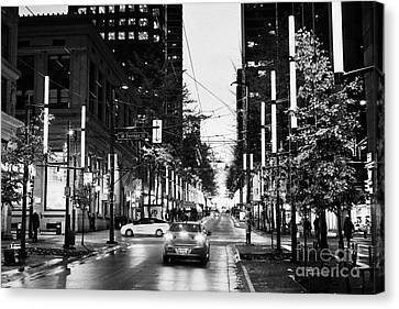 junction of west pender street and granville downtown city at night Vancouver BC Canada Canvas Print by Joe Fox