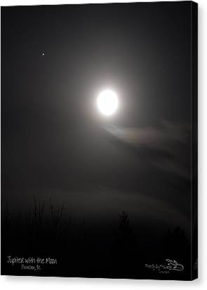 Jupiter With The Moon Canvas Print by Guy Hoffman