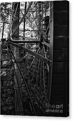 Just A Few Spokes Canvas Print by Wayne Stacy