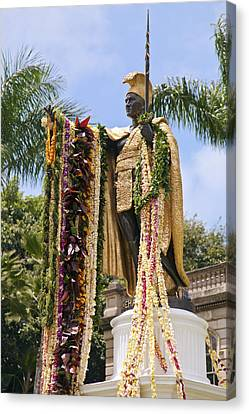Kamehameha Covered In Leis Canvas Print by Brandon Tabiolo