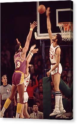 Basketball Canvas Print - Kareem Abdul Jabbar Blocks Wilt Chamberlain by Retro Images Archive