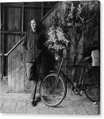 Katharine Shields By A Bicycle Canvas Print by Richard Rutledge