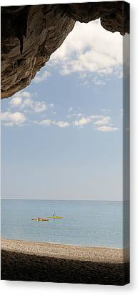 Kayak In The Sea Viewed From Cave, Cala Canvas Print by Panoramic Images