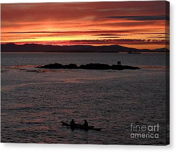 Canvas Print featuring the photograph Kayak Sunset by Gayle Swigart