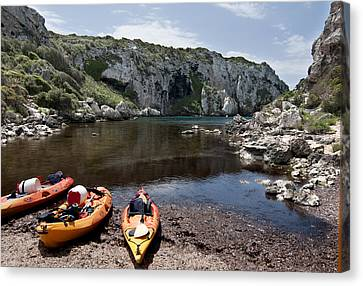 Kayak Time - The Landscape Of Cales Coves Menorca Is A Great Place For Peace And Sport Canvas Print by Pedro Cardona Llambias