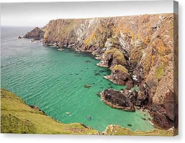 Kayakers In A Cove Near Mullion Cove Canvas Print by Ashley Cooper