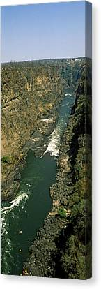 Rivers In The Fall Canvas Print - Kayakers Paddle Down The Zambezi Gorge by Panoramic Images