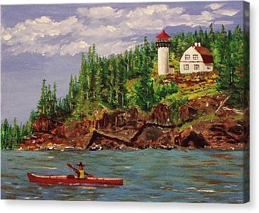 Kayaking The Coast Canvas Print by Mike Caitham