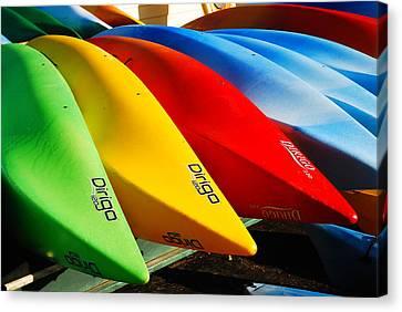 Kayaks Await Canvas Print by James Kirkikis