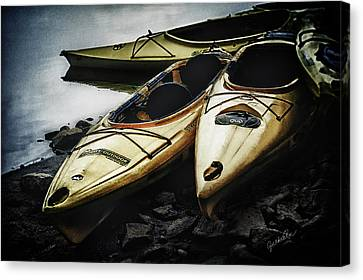 Kayaks On The Bank Canvas Print by Cynthia Roe