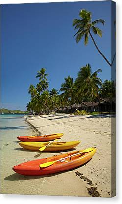 Kayaks On The Beach, Plantation Island Canvas Print