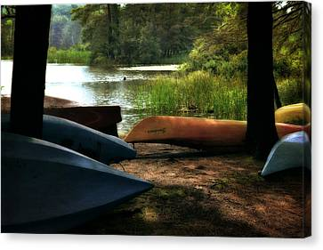Kayaks On The Shore Canvas Print by Michelle Calkins