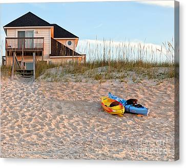 Kayaks Rest On Sand Dune In Morning Sun. Canvas Print