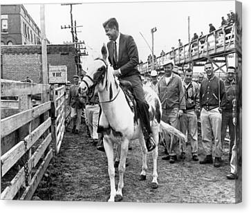 Kennedy Rides A Mule Canvas Print by Underwood Archives