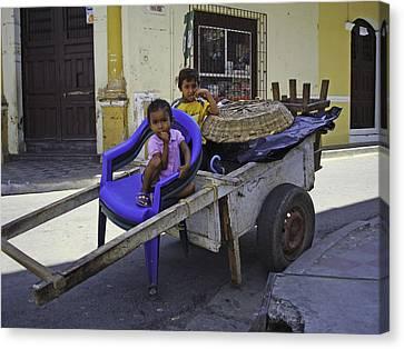 Kids In Wooden Wheel Barrel Canvas Print