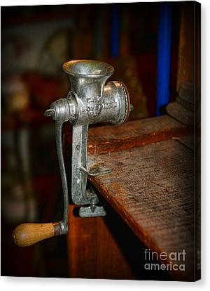 Kitchen - The Meat Grinder Canvas Print by Paul Ward