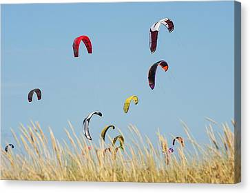 Kites Of Kite Surfers In Front Of Hotel Canvas Print by Ben Welsh