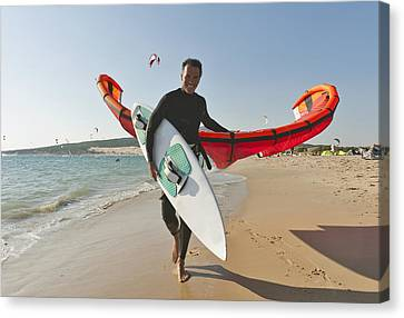 Kitesurfer On The Beach Tarifa Cadiz Canvas Print by Ben Welsh