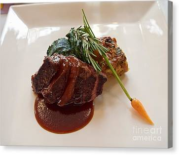 Kobe Beef With Spring Spinach And A Wild Mushroom Bread Pudding Canvas Print by Louise Heusinkveld