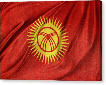 Kyrgyzstan Flag Canvas Print by Les Cunliffe