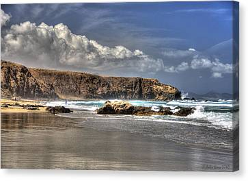 Canvas Print featuring the photograph La Pared Cliff And Rocky Beach On Fuertaventura Island by Julis Simo