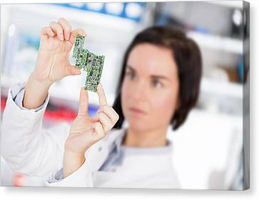 Lab Assistant Holding Circuit Board Canvas Print by Wladimir Bulgar