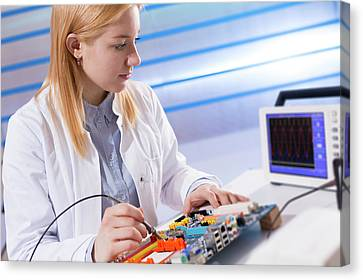 Lab Assistant Working On Circuit Board Canvas Print