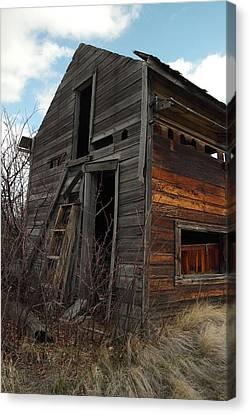 Ladder Against A Barn Wall Canvas Print by Jeff Swan