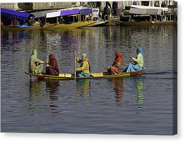 Ladies On A Wooden Boat On The Dal Lake Canvas Print by Ashish Agarwal