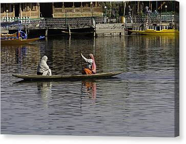 Ladies Plying A Small Boat In The Dal Lake In Srinagar - In Fron Canvas Print by Ashish Agarwal