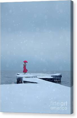 Lady In Red On Snowy Pier Canvas Print by Jill Battaglia