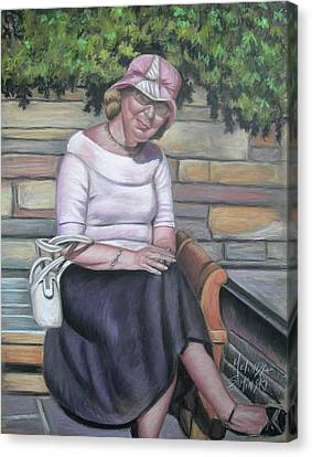 Lady Sitting On A Bench With Pink Hat Canvas Print by Melinda Saminski