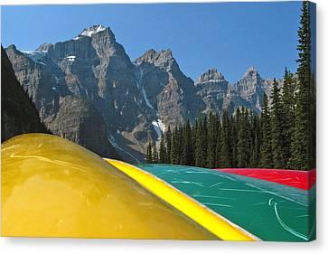 Lake Louise Canoe Canvas Print by Kurt Gustafson