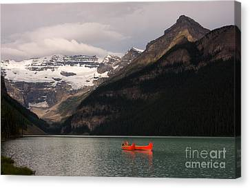 Canvas Print featuring the photograph Lake Louise Canoes by Chris Scroggins