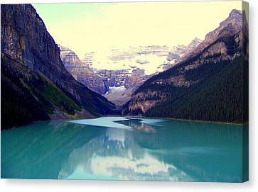 Lake Louise Stillness Canvas Print by Karen Wiles