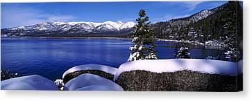 Lake With A Snowcapped Mountain Range Canvas Print by Panoramic Images