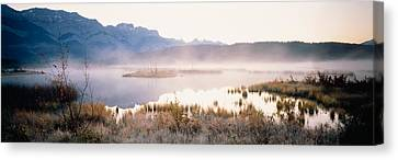 Lake With Mountains In The Background Canvas Print