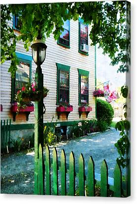 Lamp And Window Boxes Canvas Print by Susan Savad