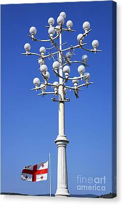 Lamp Post And Flag Georgia Canvas Print by Robert Preston