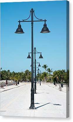 Lamp Posts White Street Pier Key West Canvas Print by Ian Monk