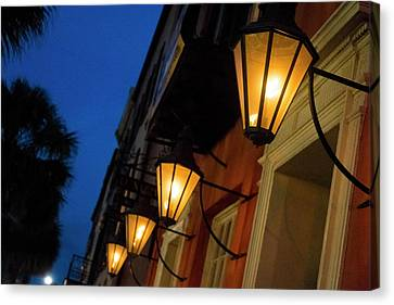 Lamps Lining The Streets At Duck Canvas Print by Julien Mcroberts