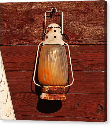 Lantern On Red Canvas Print by Art Block Collections