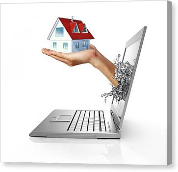 Laptop With Hand Holding Model House Canvas Print by Leonello Calvetti