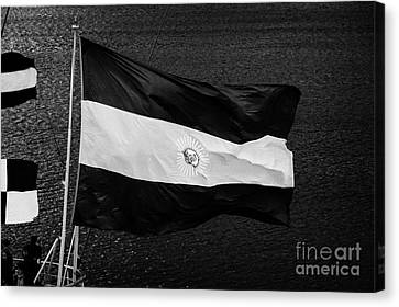 large argentinian flag flying off the back of a boat in Ushuaia Argentina Canvas Print by Joe Fox