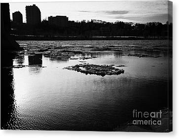 large chunks of floating ice on the south saskatchewan river in winter flowing through downtown Sask Canvas Print by Joe Fox