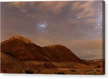 Large Magellanic Cloud Over Badlands Canvas Print by Luis Argerich