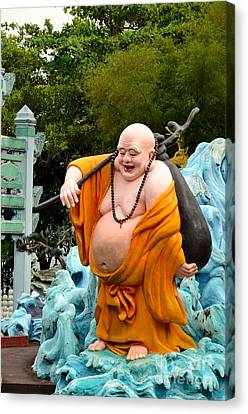 Laughing Buddhist Monk On Journey Canvas Print by Imran Ahmed