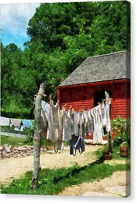 Laundry Hanging On Line Canvas Print by Susan Savad