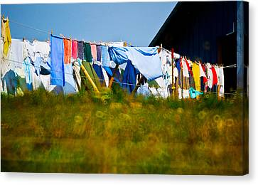 Laundry Canvas Print - Laundry Hanging On The Line To Dry by Panoramic Images